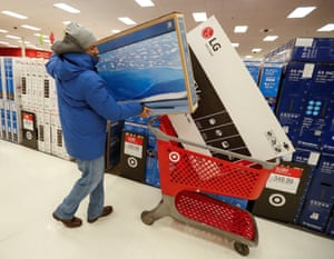 A customer loads his shopping cart at Target in Chicago, Illinois