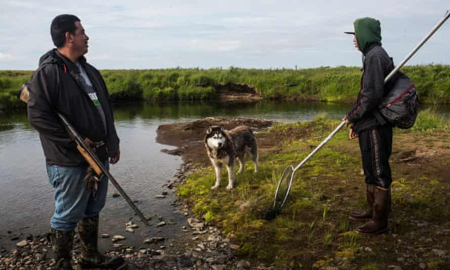 People and a dog hunt for ducks near Newtok, Alaska. Newtok has a population of approximately of 375 ethnically Yupik people.