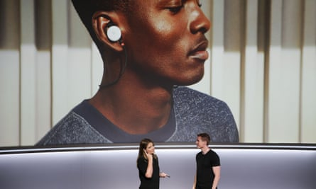 Google Pixel Buds and the Google Pixel 2 smartphone at a product launch in October.