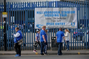 Home fans arrive past a sign advertising the event last Sunday a wedding fair before the Sheffield Wednesday v Sheffield United EFL Championship match.
