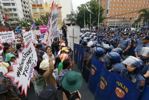Manila, PhilippinesWomen carrying placards are blocked by police as they march towards the US Embassy