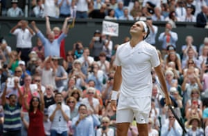 Roger Federer celebrates winning the men's singles final for a record eighth time on Centre Court.