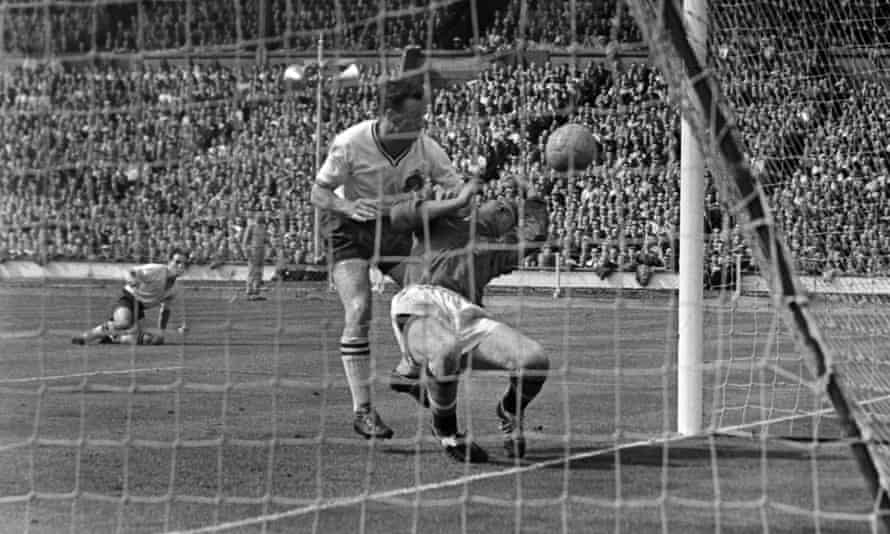 Harry Gregg for Manchester United in collision with Nat Lofthouse of Bolton Wanderers during the 1958 FA Cup final, which Bolton won 2-0.