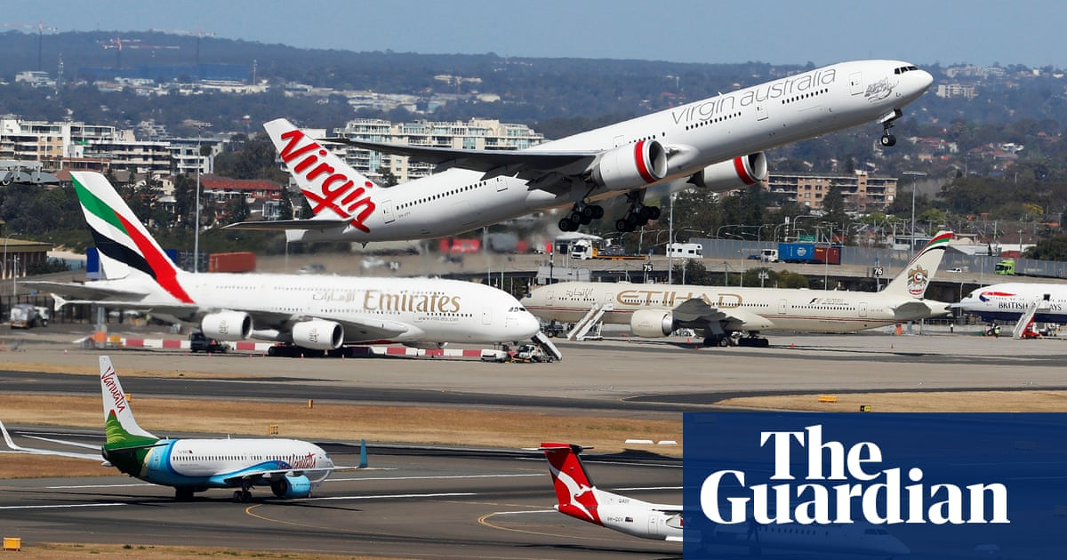 Coronavirus: Australia's top health official says there is 'no current need' to enhance airport screening - The Guardian image