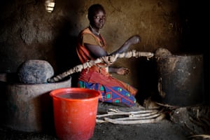 A woman boils milk at her home in Angui.