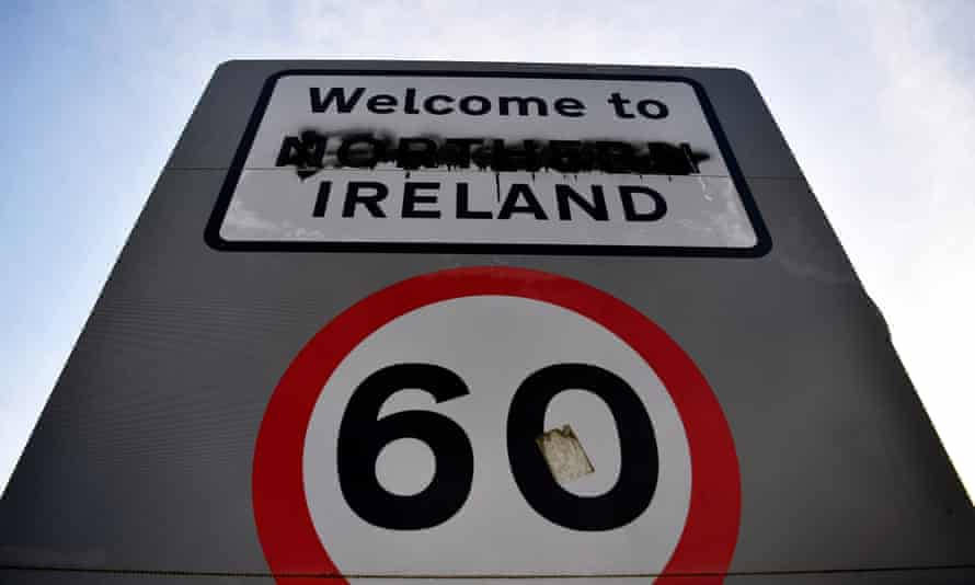 A defaced sign designates the border between the Republic of Ireland and Northern Ireland