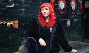 Hollie Singer, a member of the band, Adwaith, poses in music venue Clwb Ifor Bach in Cardiff.