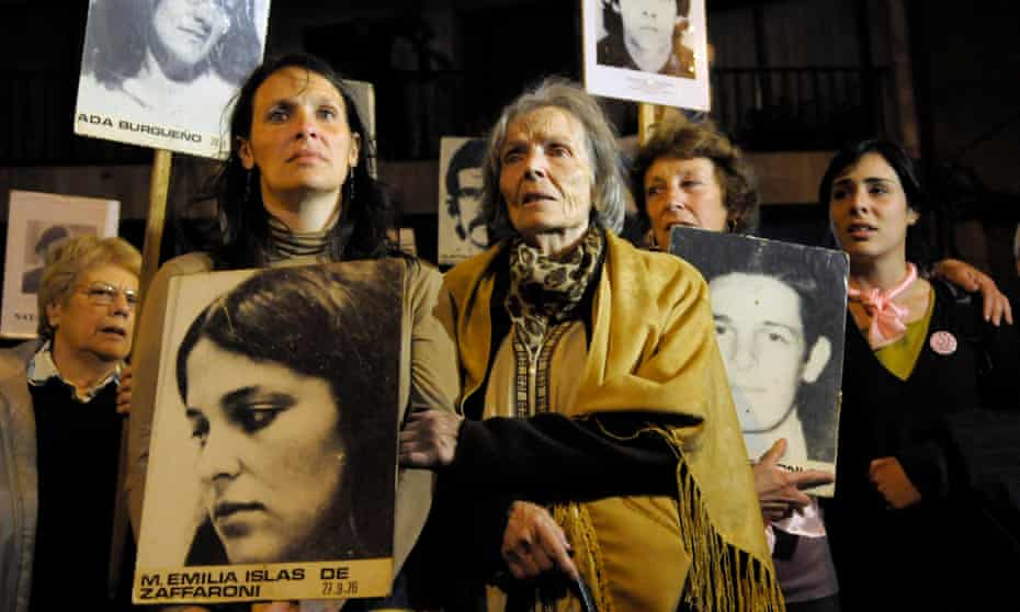 Mariana Zaffaroni Islas, front left, stands next to her grandmother María Esther Gatti de Islas at a 2009 demonstration in Montevideo, Uruguay. Her parents were killed as part of Operation Condor in Buenos Aires in 1976.
