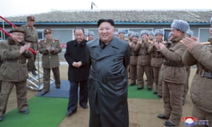 North Korean leader Kim Jong-un, in his new jacket, surrounded by a military unit