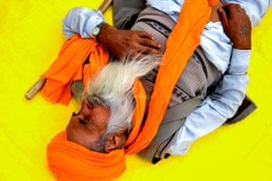 A farmer takes a nap at the Delhi-Uttar Pradesh state border in Ghazipur. Farmers have been protesting the laws for nearly two months in Punjab and Haryana states. The situation escalated three weeks ago when tens of thousands marched to New Delhi