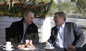Vladimir Putin and Thomas Bach share a joke over coffee and macaroons