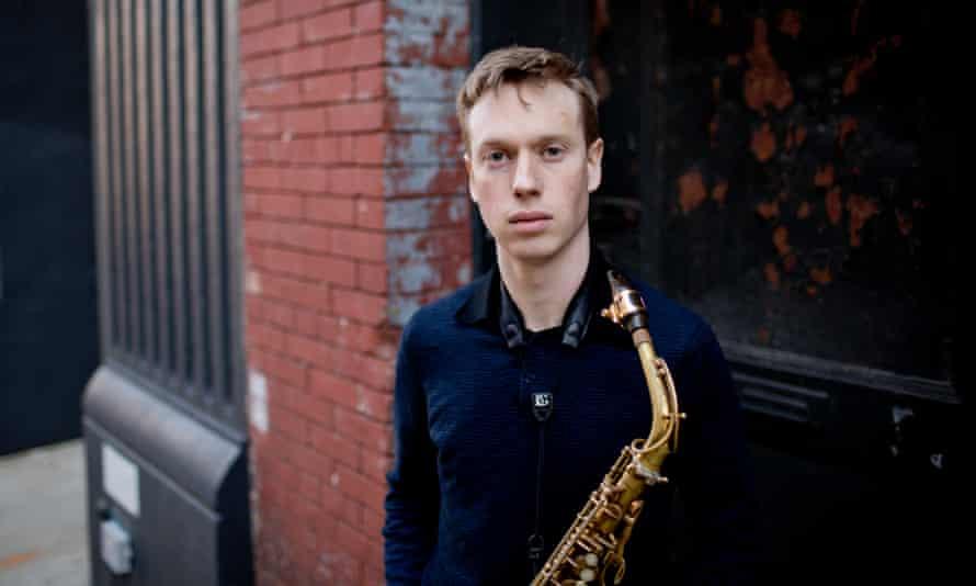 sam braysher holding an alto saxophone
