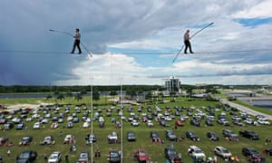 High wire artists Nik and Blake Wallenda perform at Nik Wallenda's Daredevil Rally, billed as the world's first drive-in stunt show in Sarasota, Florida.