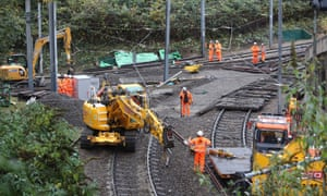 Workers repair the section of track where the tram crashed in Croydon.