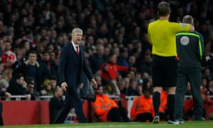 Arsene Wenger makes his feelings clear to the officials.