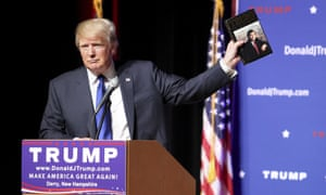 Read it and weep ... Donald Trump brandishes a copy of his 1987 book The Art of the Deal
