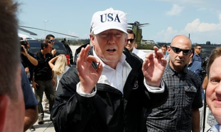 Trump greets people as he arrives to view Hurricane Irma recovery efforts in Naples, Florida. On Air Force One, he described a 'great talk' with Tim Scott.