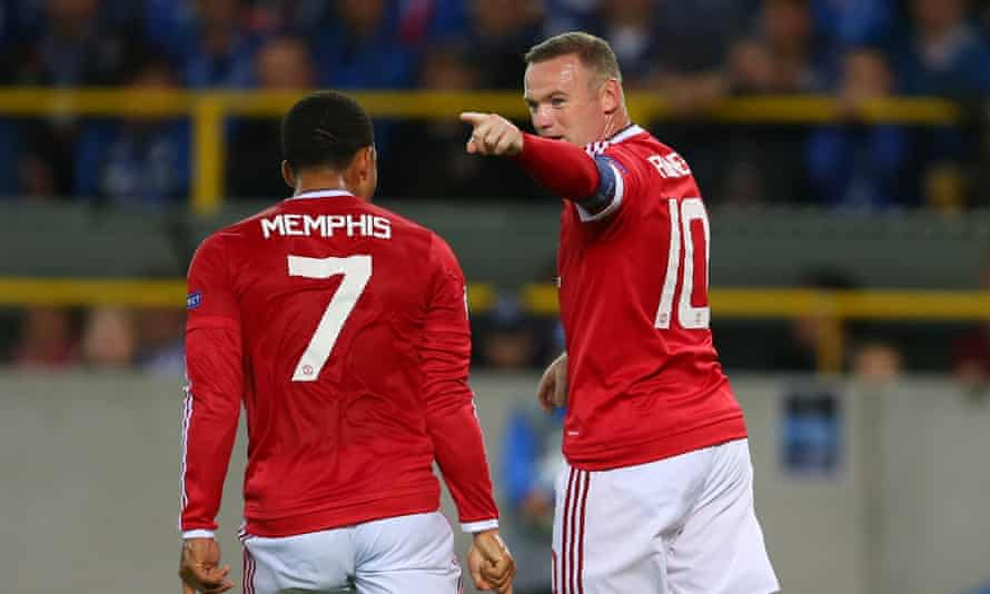 Wayne Rooney celebrates with Memphis Depay during Manchester United's qualifying play-off victory over Club Brugge.