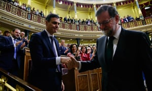 The new Spanish prime minister, Pedro Sánchez, left, shakes hands with his predecessor, Mariano Rajoy, after Sánchez won the no-confidence motion.