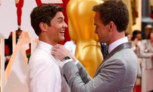 Oscars host Neil Patrick Harris adjusts the tie of his husband David Burtka