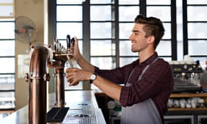 Bartender pouring beer at microbrewery