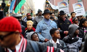 Rev Jesse Jackson and the Rainbow Push Coalition lead a protest through the Chicago Loop in response to the Laquan McDonald shooting and continuing Chicago Police investigation.