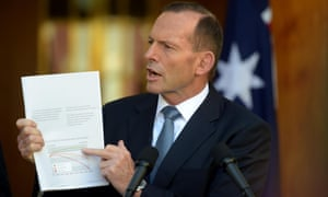 Prime minister Tony Abbott holds up the intergenerational report to back up his government's economic management record on Wednesday.
