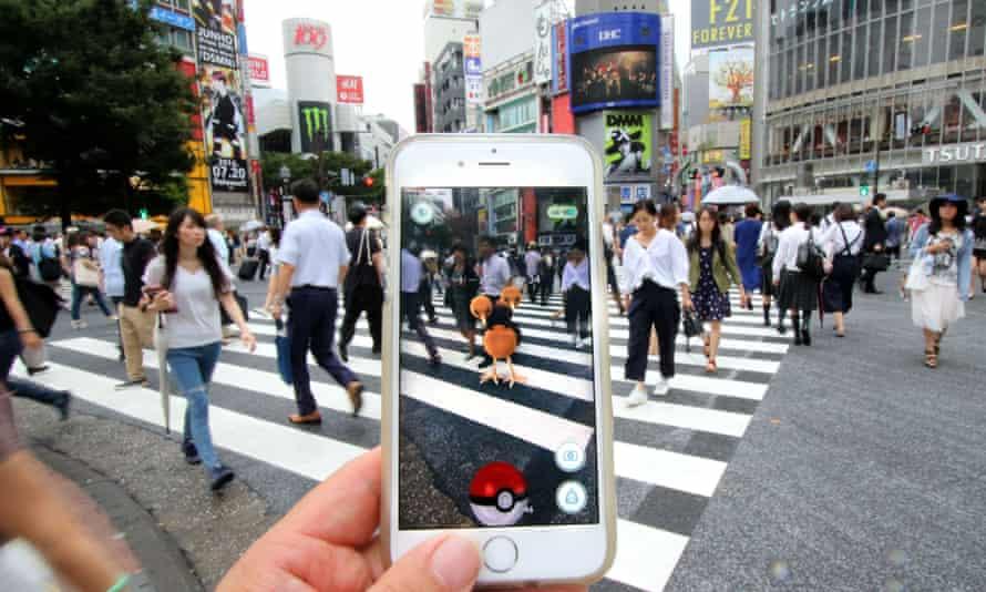 A Pokemon Go! player hunts Pokemon in Tokyo, Japan.