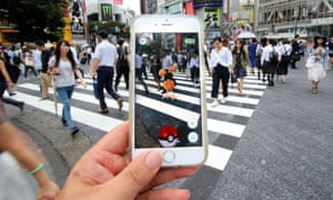 The game being played at Tokyo's famous Shibuya crossing. 'While we're all busy playing Pokemon, the companies are following the game's advice – Gotta catch 'em all'