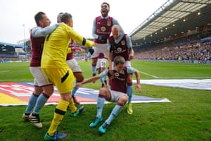 Gardner is mobbed by his team-mates, including Villa's goalkeeper Pierluigi Gollini