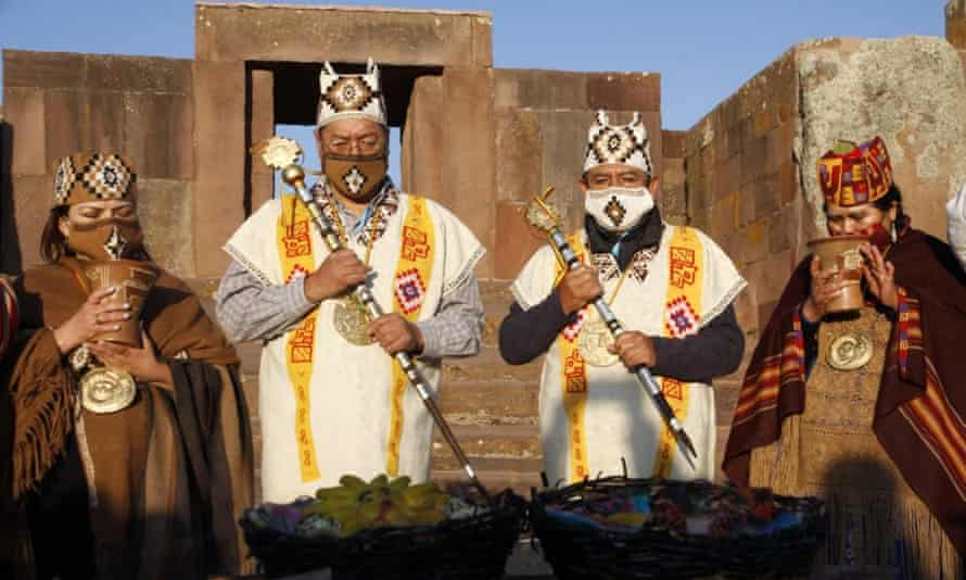 Bolivia's president Luis Arce, second left, and vice-president David Choquehuanca, during a ceremony at the pre-Inca site of Tiwanaku.