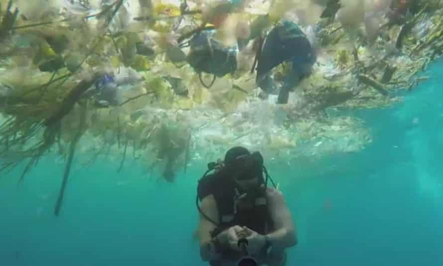 Screengrab from footage taken by Rich Horner as he swims through masses of plastic waste off Bali