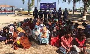 Rohingya refugees wait after their boat capsized near the Saint Martin's island in the Bay of Bengal, in Teknaf, near Cox's Bazar, Bangladesh, 11 February, 2020.