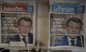Front pages of two newspapers showing Emmanuel Macron telling French citizens to stay at home