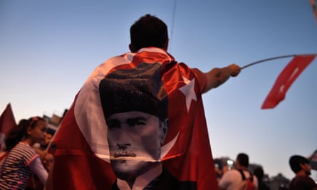 A boy is wrapped in a Mustafa Kemal flag following the failed coup in July 2016.