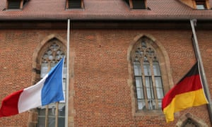 The flags of France and Germany at half-mast in front of the Holy Spirit House in Nuremberg, Germany, one of Nice's twin cities.