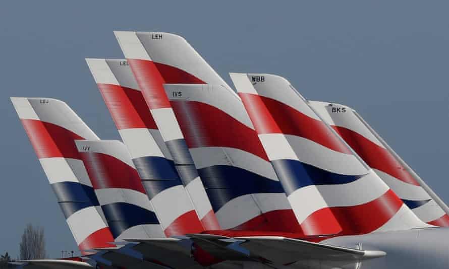 Tailfins of British Airways planes parked at Heathrow airport.