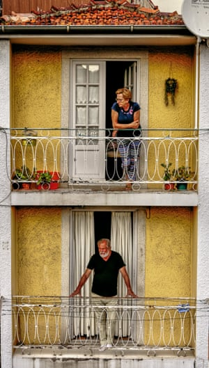 While strolling around Porto I passed this couple observing the world from their respective balconies. The juxtaposition of two separate individuals in a similar pose was very striking.