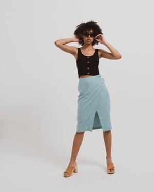 Model wears skirt, £50, asos.com. Vest, £12.99, hm.com. Sandals, £180, swedishhasbeens.com. Sunglasses, €59, shop.komono.com