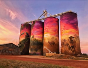 The Watering Hole, by artists Joel Fergie and Travis Vinson, is found on the GrainCorp silos in the town of Thallon in Queensland. It depicts a vibrant sunset over the nearby Moonie River and reflects the agricultural aspect of the region.
