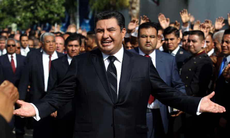This picture taken on August 9, 2017 shows the leader of the Church of the Light of the World, Naason Joaquin Garcia, walking among his parishioners in Guadalajara, Mexico.