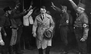 FILE - In this Dec. 5, 2013 file photo Adolf Hitler, leader of the National Socialists, emerges from the party's Munich headquarters. Historical documents show Adolf Hitler enjoyed special treatment, including plentiful supplies of beer, during his time in Landsberg prison.  (AP Photo/file)