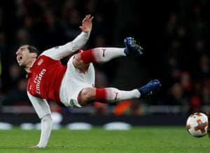 Arsenal's Henrikh Mkhitaryan goes flying after being clattered into by CSKA Moscow's Georgi Schennikov.