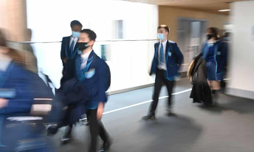 Students wearing masks as they move between classrooms in March.
