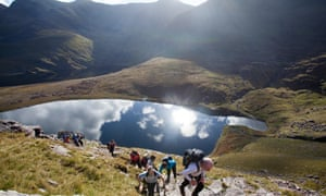 Walkers above Lough Gouragh on the ascent of Carrauntoohill