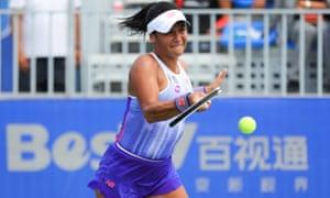 Heather Watson returns a shot in a Wuhan Open qualifying match against Liu Chang.