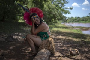 Minas Gerais, BrazilA woman from the Pataxo Ha-ha-hae community weeps while looking at the mud covered Paraopeba river after a dam collapsed at an iron-ore mine near the town of Brumadinho