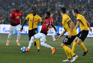 Young Boys' Sékou Sanogo vies with Manchester United's Fred.