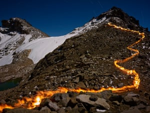 At about 5,000m on Mount Kenya, Simon Norfolk carried a self-made fire torch to create a line of fine showing where the glacier used to extend to