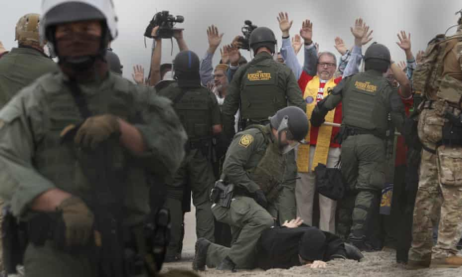 US Border Patrol agents arrest people during a multi-faith pro-migration protest on the US-Mexico border in San Diego.